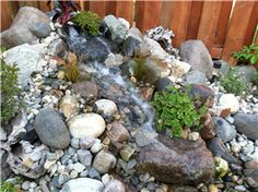 This scale... Using a mixture of boulders the 3-4ft stream bed has scale, strong 1,800gph water flow and can be built practically anywhere in your landsca...