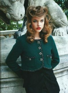 a very young Natalia Vodianova wearing emerald Chanel