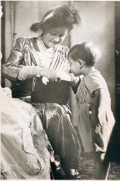 Prince Charles looks on as his grandmother, the Queen Mother Elizabeth, looks in her purse at the christening of Charles' sister, Anne. So cute this picture for the Queen Mother and her Grand son Prince Charles.