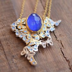 The reflection of the blue gemstone attracts the finesse parts of the butterfly ! Blue Gemstones, Reflection, Butterfly, Pendant Necklace, Instagram, Jewelry, Jewlery, Bijoux, Schmuck