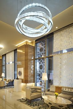 chandelier and walls... partitions  Kempinski Hotel Mall of the Emirates, Dubai designed by Wilson Asocciates :: Lasvit light