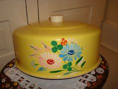 yellow cake cover with painted flowers
