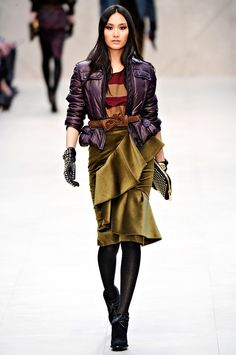 Burberry Prorsum Fall 2012. Faux leather, stripes, textured gloves and purse....all blended together. Love the combination of colors, fabrics, and details. -Penny-