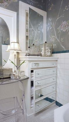 fake drawers - not sure about the mirrors but love the chest looking cabinet with faux drawer fronts