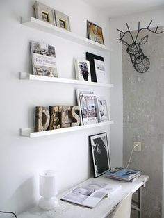 Ikea wall shelves. Like these for displaying photos.