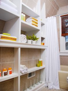 A creative way to add functional and stylish shelving storage to a small bathroom.