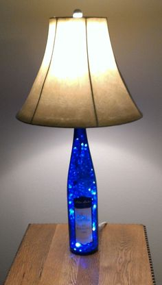 These DIY Old Wine Bottle Crafts are so amazing that you will love to put them on display for your guests. Old Wine Bottles, Wine Bottle Corks, Lighted Wine Bottles, Bottle Lights, Wine Bottle Crafts, Glass Bottles, Glass Jug, Diy Bottle Lamp, Wine Bottle Lamps