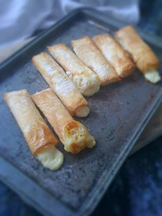 Baked Halloumi cheese rolls (made with filo pastry). Cut filo pastry into rectangles, place halloumi (Must try another cheese too! bake, 350 to brown. Baked Halloumi, Haloumi Cheese, Yummy Food, Tasty, Savory Snacks, Appetizer Recipes, Appetizers, Dinner Recipes, Filo Pastry