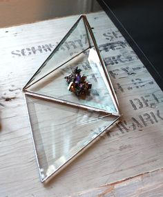 glass pyramid with mineral specimen