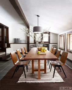 Large wood rectangular dining table in this neutral colored dining room