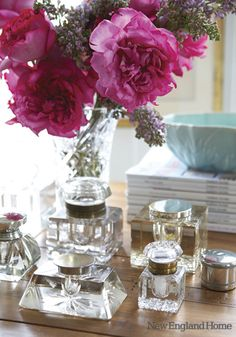 Dark pink flowers in clear glass vase