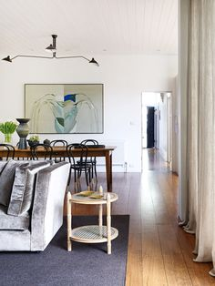 Penelope Hall. Love the flow from this dining room to living room. The Design Files