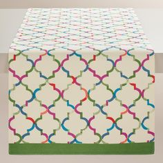 Just in time for spring, our cheerful, multicolor lattice-print table runner flaunts a modern vibe with its green trim and geometric details.