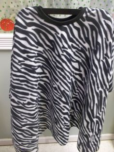 Zebra print fleece poncho. The back of this one is longer than the front just what is in style right now. hand made by Pam. by GranniesCoolAttic on Etsy