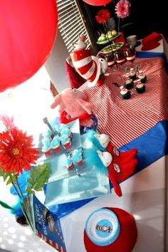 "Party table for ""thing one--thing two"" baby shower party."