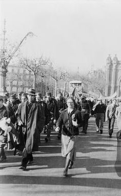 THE SPANISH CIVIL WAR, 1936-1939The Abraham Lincoln Battalion, the first American unit to fight with the International Brigade, marching through Barcelona, 1937. Winifred Bates is in the centre of this photograph.