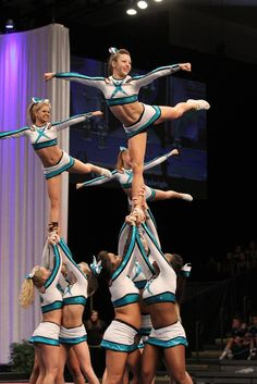 CHEER  Extreme stunt cheerleaders competition arabesque from Kythoni's Cheerleading: Competitive board http://pinterest.com/kythoni/cheerleading-competitive/ #KyFun m.22.132