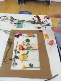 Leftover flowers pressed onto layers of contact paper and then hung in the window.