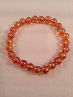 Tangerine Aura Quartz 8mm Round Stretch Bead Bracelet https://www.etsy.com/listing/228867054/tangerine-aura-quartz-8mm-round-stretch