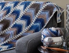 Mary Maxim - Chevron Panels Throw - New Items - A beautiful design to crochet for your home. The Chevron Panels Throw, for the intermediate crocheter, is crocheted in nine panels using the gorgeous colors of Mary Maxim Prism 100% acrylic yarn and joined together using Mary Maxim Best Value 100% acrylic worsted weight yarn. Due to the nature of Prism yarn, no two throws will have exactly the same color placement, making each throw unique.