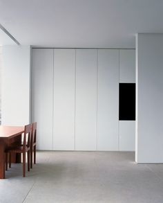 Greenwood apartment, London. Dining room and invisible kitchen. Gavin Jackson Architects.