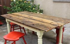 Wood Plank Dining Table, also love the red used-to-be-chairs stools!
