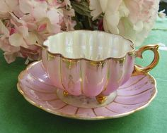 Vintage footed teacup and saucer, Royal Sealy, Japan, iridescent lustre by 2rivers on Etsy https://www.etsy.com/listing/241687908/vintage-footed-teacup-and-saucer-royal