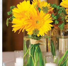 Simple arrangements of yellow gerbera daisies and green mums added color to the tables.