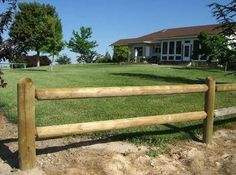 Round gumpole, rail and post fence. Garden delineation.
