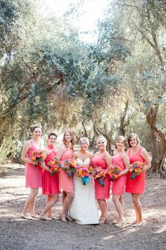 Coral bridesmaids dresses  Photography: Candice Benjamin Photography - candicebenjamin.com  Read More: http://www.stylemepretty.com/california-weddings/2014/04/22/black-white-striped-wedding-in-an-olive-grove/