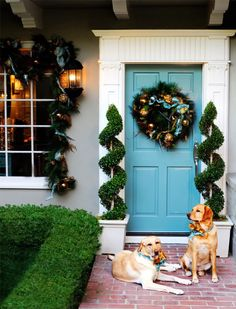 Love the turquoise door and decorations.  The greenery around the window and the topiaries are beautiful. A gorgeous holiday entrance!