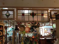The Elegant Attic in Buxton, NC.The shop's main feature is a spectacular selection of antique stained-glass windows and doors imported from England.