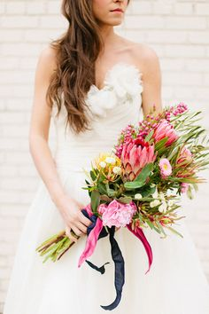 protea and peony bouquet, photo by Morgan Trinker http://ruffledblog.com/the-notwedding-birmingham #flowers #weddingbouquet #pink