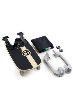 Orbit baby Skate board for kid #2 on the back of stroller.