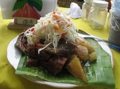 "Baho, or vaho, is one of the cornerstones of Nicaraguan cuisine. Beef, plantains and yuca (cassava) are wrapped in banana leaves and steamed over water in a large pot. Baho is food for a Sunday afternoon. Start the recipe on Saturday by marinating the meat. Vaho means ""mist"" in Spanish and evokes the unique cooking method for this hearty meal."