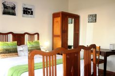 This room also has a kitchen and a private entrance. Guesthouse in Pretoria. Pretoria, Breath In Breath Out, Wooden Furniture, Crisp, Entrance, Antiques, Bed, Kitchen, Room