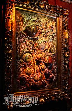 Creepy art made using: old frame, Great Stuff (foam insulation), different sized eyeballs...