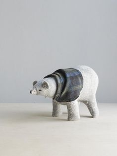 A polar bear in a woolen cape is festive (and cozy!).