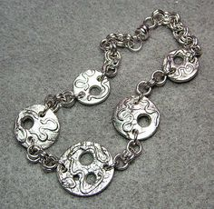 I had fun with fine silver clay a few years back, and made these links.  For whatever reason, I didn't like them at the time and tossed 'em in a bag.  Found them today, decided I liked them and voila -- a bracelet is born!