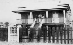 Dawson family home, Sussex Street, Maryborough  Family group at the top of the stairs and on the verandah of a Queenslander style house. The house is on high wooden stumps and there is a tall picket fence and gate