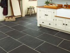 Rustic Black Slate Tiles have a marked riven surface creating a rustic charm. These tiles are readily available in a variety of sizes including the classic Opus pattern. Slate is a fine grained rock formed from layers of shale Black Slate Floor Tiles, Slate Floor Kitchen, Bathroom Floor Tiles, Kitchen Tiles, Kitchen Flooring, Kitchen Countertops, New Kitchen, Slate Tiles, Slate Bathroom