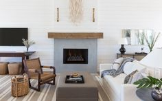 After: Flanigan simplified the living room with a clean-lined fireplace façade (and, of course, more shiplap).