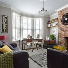 This modern open-plan living area oozes sophistication with the exposed brickwork. Add splashes of yellow, green and red for cheerful extras.
