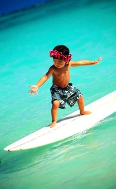 little surfer.. What a fabulous shot! He looks like a natural <<<< well what do you expect he's Hawaiian!!!