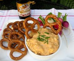 Obatzta is a traditional Bavarian dish served with pretzels and radishes.