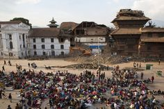 People gather on an open space for security reasons at the Basantapur Durbar Square, damaged in Saturday's earthquake in Kathmandu,on April 26, 2015.