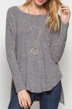 6e19972afd5 This lightweight heather grey knit long sleeved top is perfect for those  casual fall days &