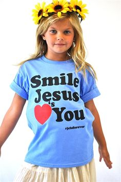 A simple message tee, Smile Jesus Loves You. Printed on a baby blue tee. This tee has a message that should make you smile :) $14.99