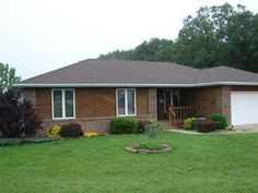 Sharp brick and cedar sided home on 3 acres just outside Marshfield,MO city limits. Home is a 3 bedroom, 2 bath, vaulted ceiling in living room, wood burning free standing stove, and quality built. Also, includes a detached 2 car garage/workshop with concrete floor. Back deck, covered front porch, nice pretty yard, fenced, pasture, and more.