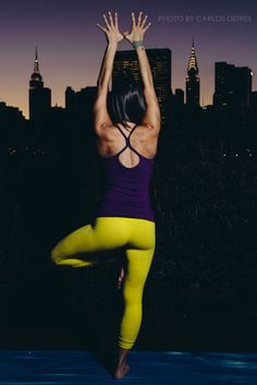 A Yoga Instructor with the Manhattan Skyline in the Background  Photo by Carlos Detres https://www.facebook.com/carlosdetresphoto